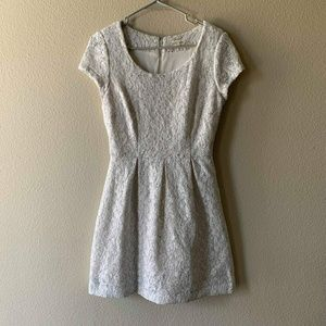 White lace babydoll dress with silver detail